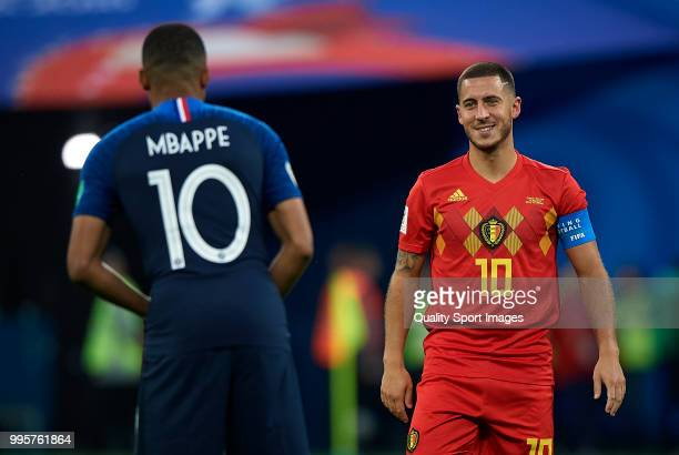 Eden Hazard of Belgium talks with Kylian Mbappe of France during the 2018 FIFA World Cup Russia Semi Final match between Belgium and France at Saint...