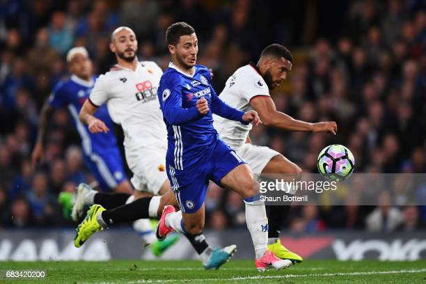 Eden Hazard of Chelsea and Adrian Mariappa of Watford battle for possession during the Premier League match between Chelsea and Watford at Stamford...