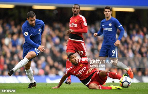 Eden Hazard of Chelsea and Adrian Mariappa of Watford during the Premier League match between Chelsea and Watford at Stamford Bridge on October 21...