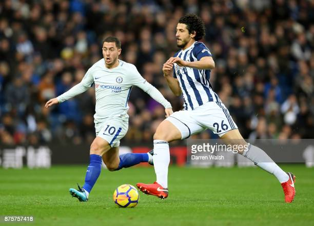Eden Hazard of Chelsea and Ahmed ElSayed Hegazi of West Bromwich Albion compete for the ball during the Premier League match between West Bromwich...