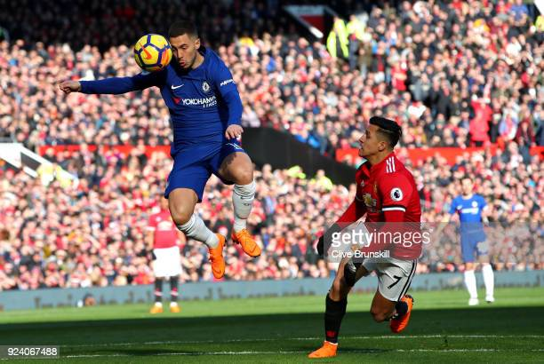 Eden Hazard of Chelsea and Alexis Sanchez of Manchester United in action during the Premier League match between Manchester United and Chelsea at Old...