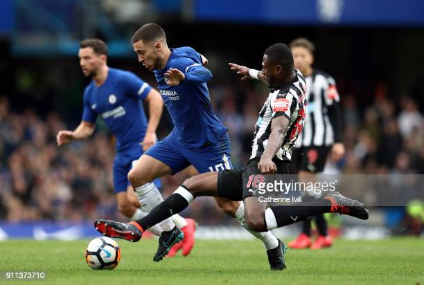 Eden Hazard of Chelsea and Chancel Mbemba of Newcastle United during the Emirates FA Cup Fourth Round match between Chelsea and Newcastle United on...