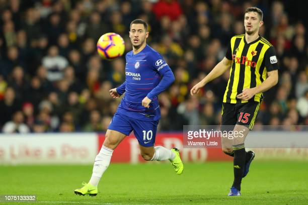 Eden Hazard of Chelsea and Craig Cathcart of Watford in action during the Premier League match between Watford FC and Chelsea FC at Vicarage Road on...