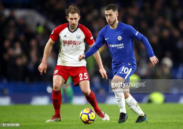 Eden Hazard of Chelsea and Craig Dawson of West Bromwich Albion in action during the Premier League match between Chelsea and West Bromwich Albion at...