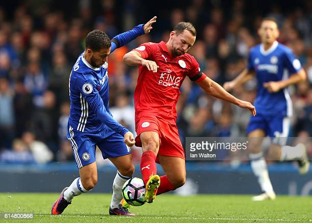 Eden Hazard of Chelsea and Daniel Drinkwater of Leicester City battle for possession during the Premier League match between Chelsea and Leicester...