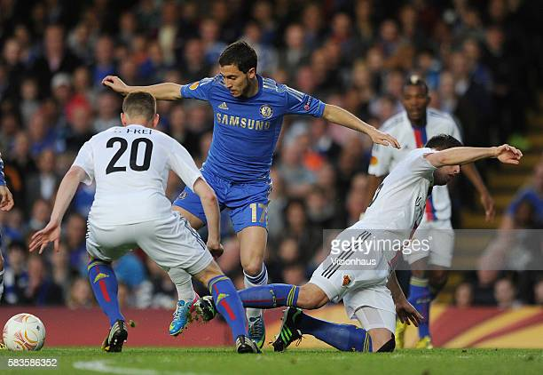 Eden Hazard of Chelsea and Fabien Frei and Fabien Schar of FC Basle during the Europa League SemiFinal 2nd Leg match between Chelsea and FC Basle...