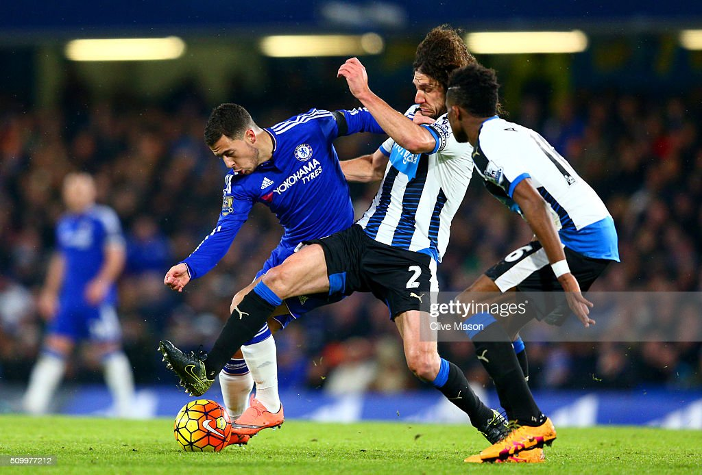 Eden Hazard of Chelsea and Fabricio Coloccini of Newcastle United compete for the ball during the Barclays Premier League match between Chelsea and Newcastle United at Stamford Bridge on February 13, 2016 in London, England.