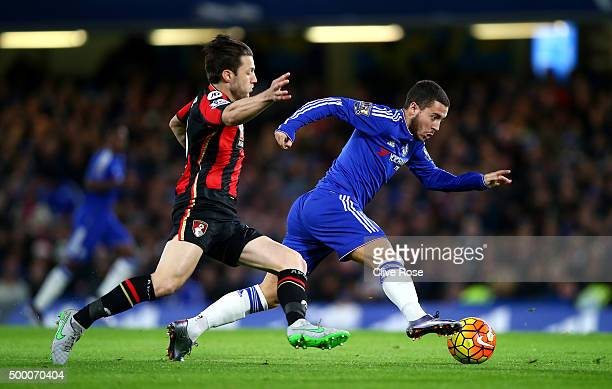 Eden Hazard of Chelsea and Harry Arter of Bournemouth compete for the ball during the Barclays Premier League match between Chelsea and AFC...