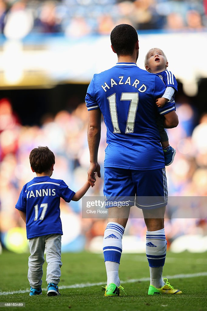 Eden Hazard of Chelsea and his family appear on the pitch following the Barclays Premier League match between Chelsea and Norwich City at Stamford Bridge on May 4, 2014 in London, England.