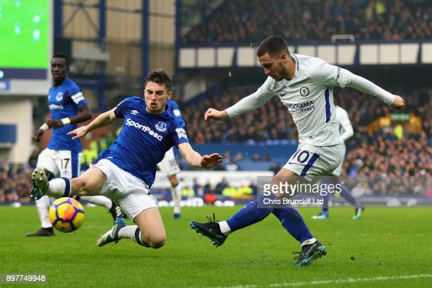 Eden Hazard of Chelsea and Jonjoe Kenny of Everton in action during the Premier League match between Everton and Chelsea at Goodison Park on December...