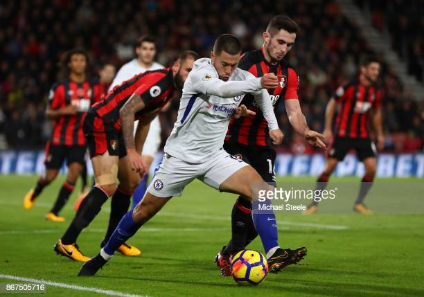 Eden Hazard of Chelsea and Lewis Cook of AFC Bournemouth battle for possession during the Premier League match between AFC Bournemouth and Chelsea at...