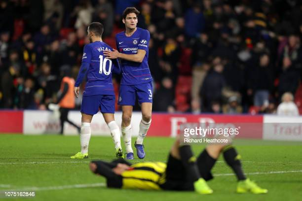 Eden Hazard of Chelsea and Marcos Alonso of Chelsea celebrate following their sides victory in the Premier League match between Watford FC and...