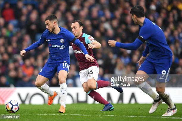 Eden Hazard of Chelsea and Mark Noble of West Ham United in action during the Premier League match between Chelsea and West Ham United at Stamford...