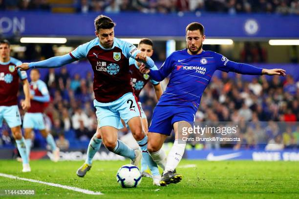Eden Hazard of Chelsea and Matthew Lowton of Burnley battle for the ball during the Premier League match between Chelsea FC and Burnley FC at...