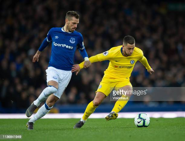Eden Hazard of Chelsea and Morgan Schneiderlin of Everton in action during the Premier League match between Everton FC and Chelsea FC at Goodison...