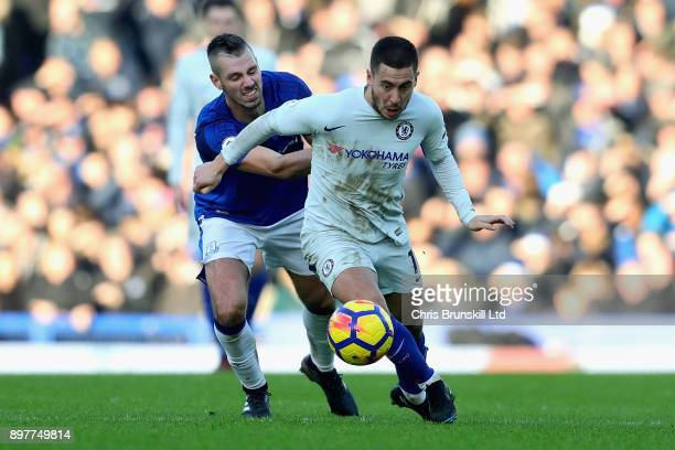 Eden Hazard of Chelsea and Morgan Schneiderlin of Everton in action during the Premier League match between Everton and Chelsea at Goodison Park on...