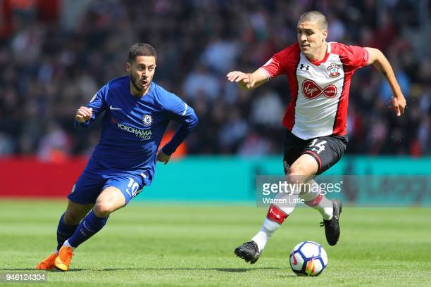 Eden Hazard of Chelsea and Oriol Romeu of Southampton battle for possession during the Premier League match between Southampton and Chelsea at St...