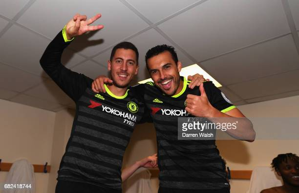 Eden Hazard of Chelsea and Pedro of Chelsea celebrate winning the leauge in the changing room after the Premier League match between West Bromwich...