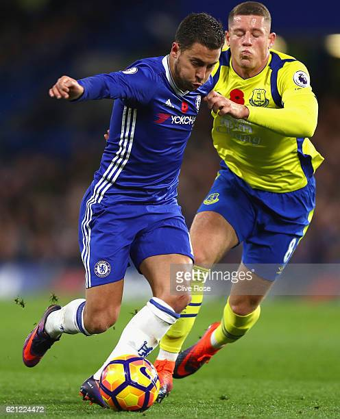 Eden Hazard of Chelsea and Ross Barkley of Everton battle for possession during the Premier League match between Chelsea and Everton at Stamford...