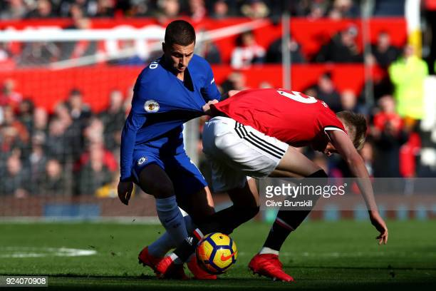Eden Hazard of Chelsea and Scott McTominay of Manchester United compete for the ball during the Premier League match between Manchester United and...