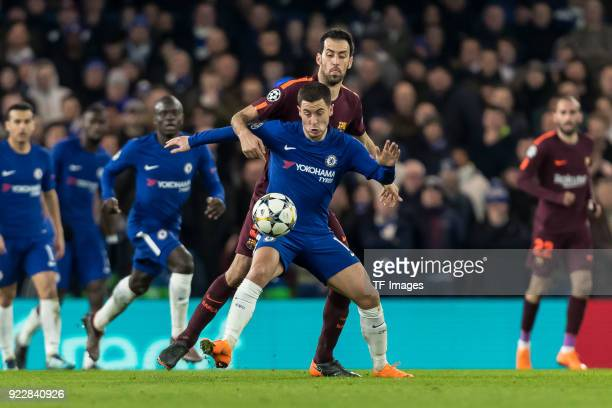 Eden Hazard of Chelsea and Sergio Busquets of Barcelona battle for the ball during the UEFA Champions League Round of 16 First Leg match between...