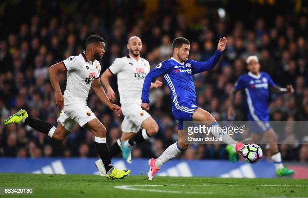 Eden Hazard of Chelsea attempts to control the ball while under pressure from Adrian Mariappa of Watford during the Premier League match between...