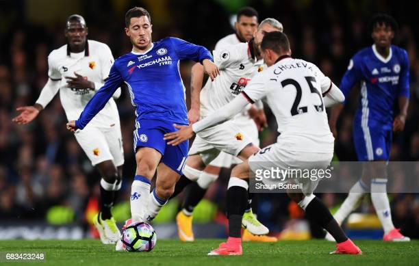 Eden Hazard of Chelsea attempts to get past Jose Holebas of Watford during the Premier League match between Chelsea and Watford at Stamford Bridge on...