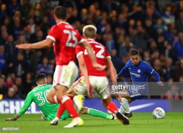 Eden Hazard of Chelsea attempts to take the ball round Stephen Henderson of Nottingham Forest during the Carabao Cup Third Round match between...