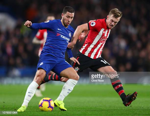 Eden Hazard of Chelsea battles for possession with James WardProwse of Southampton during the Premier League match between Chelsea FC and Southampton...