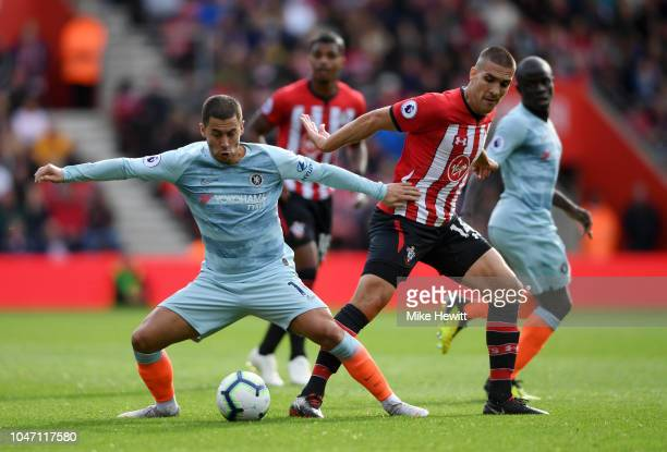 Eden Hazard of Chelsea battles for possession with Oriol Romeu of Southampton during the Premier League match between Southampton FC and Chelsea FC...