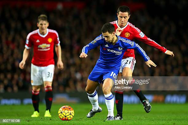 Eden Hazard of Chelsea battles for the ball with Ander Herrera of Manchester United during the Barclays Premier League match between Manchester...