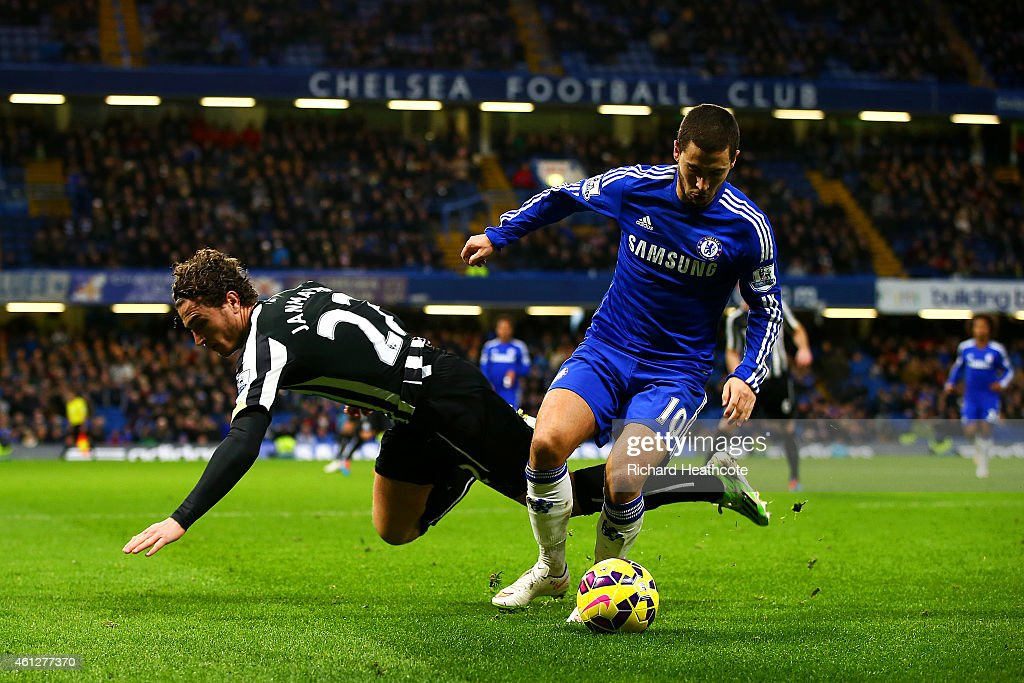 Eden Hazard Of Chelsea Battles For The Ball With Daryl