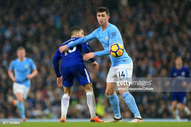 Eden Hazard of Chelsea battles with Aymeric Laporte of Man City during the Premier League match between Manchester City and Chelsea at the Etihad...