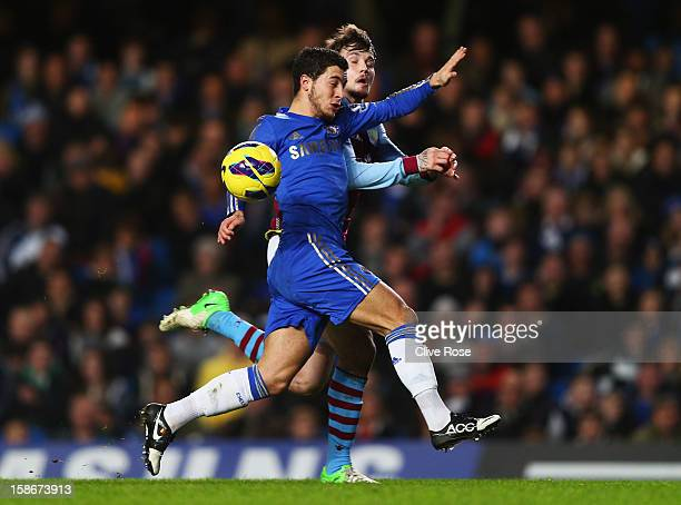 Eden Hazard of Chelsea battles with Chris Herd of Aston Villa during the Barclays Premier League match between Chelsea and Aston Villa at Stamford...