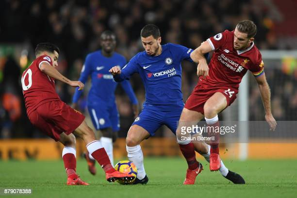 Eden Hazard of Chelsea battles with Philippe Coutinho and Jordan Henderson of Liverpool during the Premier League match between Liverpool and Chelsea...