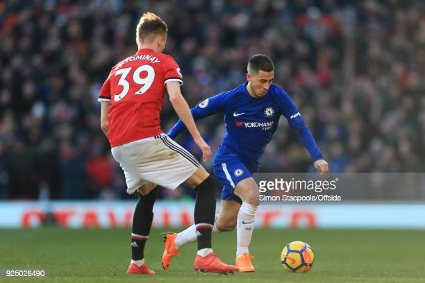 Eden Hazard of Chelsea battles with Scott McTominay of Man Utd during the Premier League match between Manchester United and Chelsea at Old Trafford...
