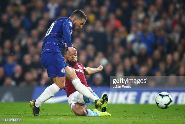 Eden Hazard of Chelsea beats Ryan Fredericks of West Ham United as he scores his team's first goal during the Premier League match between Chelsea FC...
