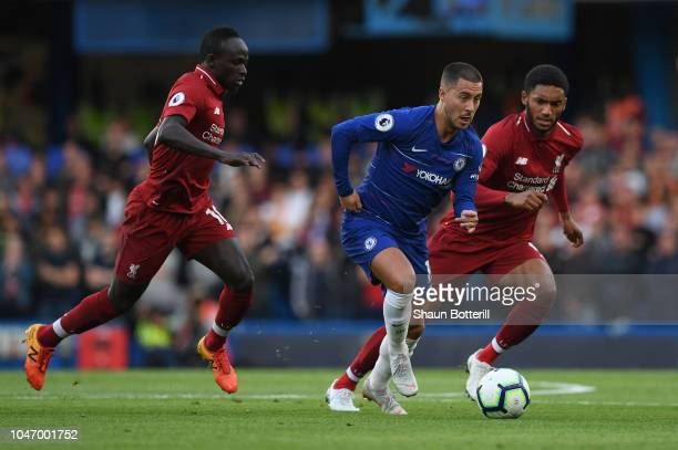 Eden Hazard of Chelsea breaks away from Sadio Mane and Joseph Gomez of Liverpool during the Premier League match between Chelsea FC and Liverpool FC...