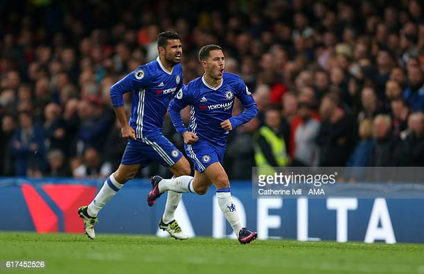 Eden Hazard of Chelsea celebrates after he scores to make it 30 with Diego Costa of Chelsea during the Premier League match between Chelsea and...