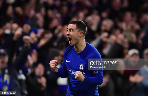 Eden Hazard of Chelsea celebrates after his shot was deflected in by Stefan Savic of Atletico Madrid for Chelsea's first goal during the UEFA...