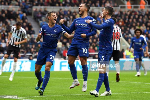 Eden Hazard of Chelsea celebrates after scoring a penalty for his team's first goal during the Premier League match between Newcastle United and...