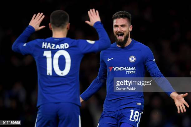Eden Hazard of Chelsea celebrates after scoring his sides first goal with Olivier Giroud of Chelsea during the Premier League match between Chelsea...
