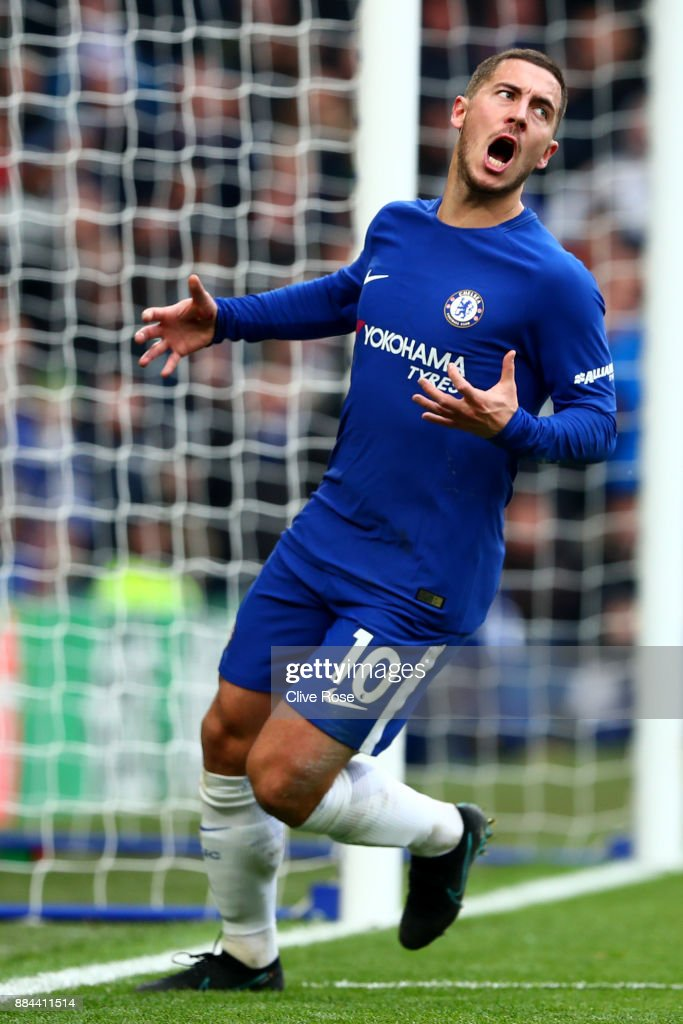 Eden Hazard of Chelsea celebrates after scoring his sides third goal during the Premier League match between Chelsea and Newcastle United at Stamford Bridge on December 2, 2017 in London, England.