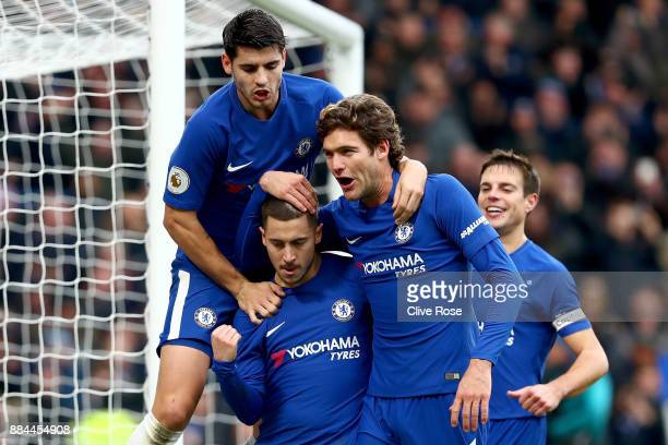 Eden Hazard of Chelsea celebrates after scoring his sides third goal with Alvaro Morata of Chelsea and Marcos Alonso of Chelsea during the Premier...