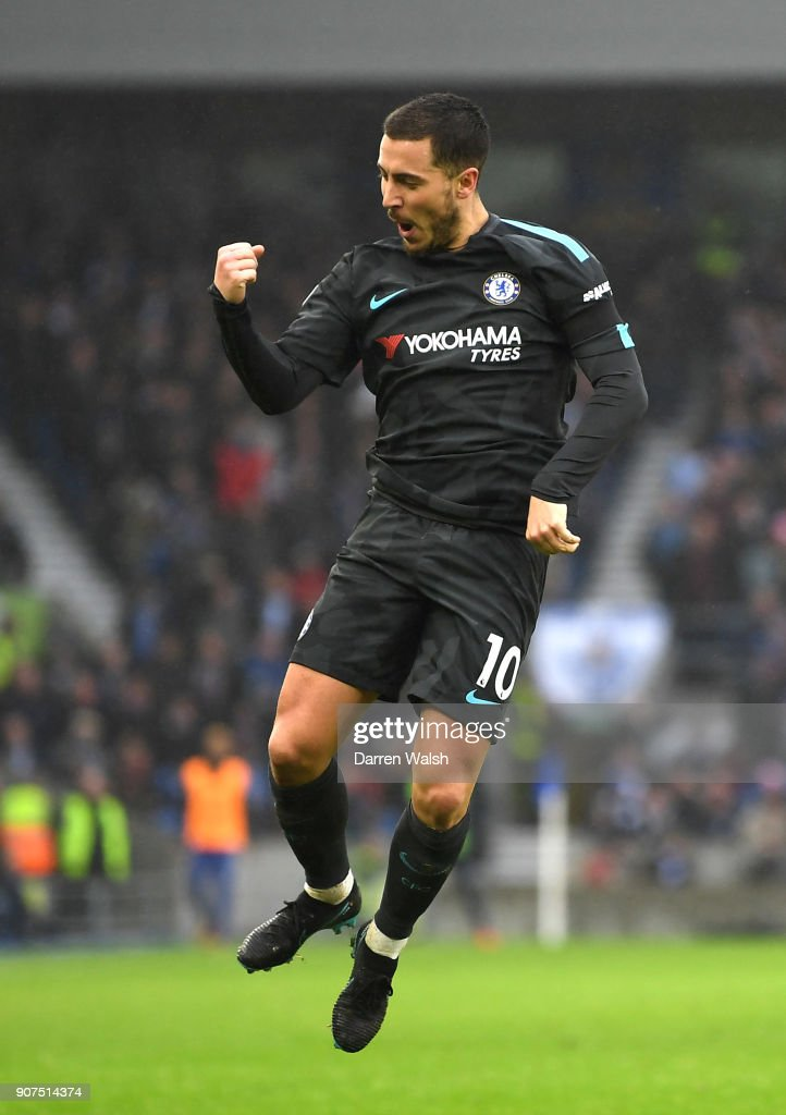Eden Hazard of Chelsea celebrates after scoring his sides third goal during the Premier League match between Brighton and Hove Albion and Chelsea at Amex Stadium on January 20, 2018 in Brighton, England.