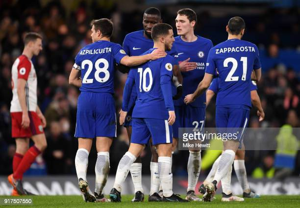 Eden Hazard of Chelsea celebrates after scoring his sides third goal with his team mates during the Premier League match between Chelsea and West...
