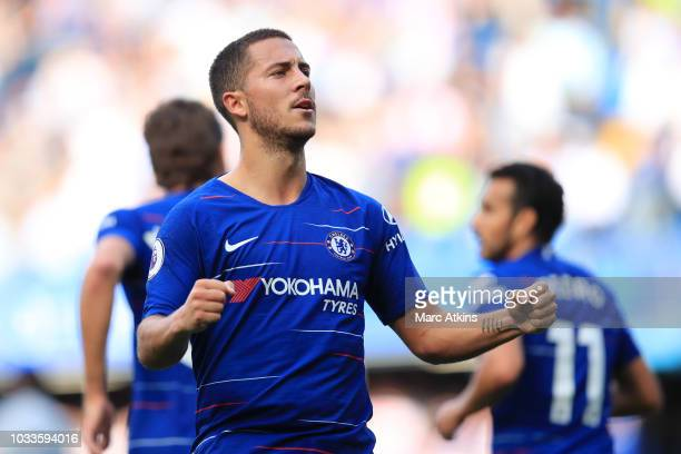 Eden Hazard of Chelsea celebrates after scoring his team's first goal during the Premier League match between Chelsea FC and Cardiff City at Stamford...
