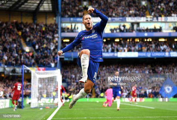 Eden Hazard of Chelsea celebrates after scoring his team's first goal during the Premier League match between Chelsea FC and Liverpool FC at Stamford...
