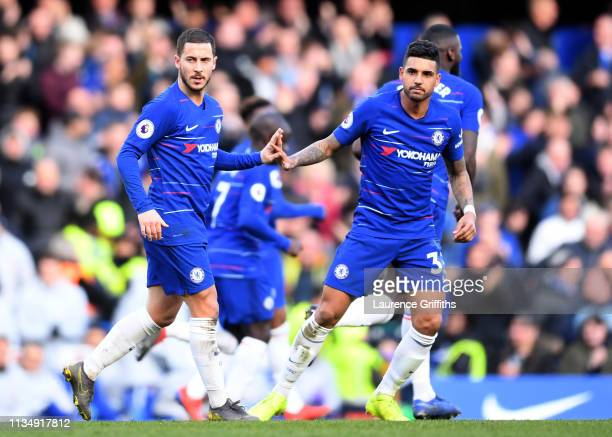 Eden Hazard of Chelsea celebrates after scoring his team's first goal with teammate Emerson during the Premier League match between Chelsea FC and...