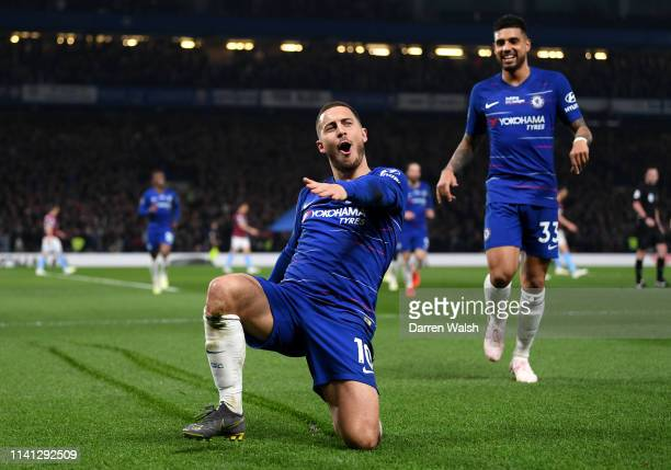 Eden Hazard of Chelsea celebrates after scoring his team's first goal during the Premier League match between Chelsea FC and West Ham United at...